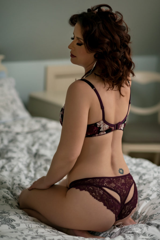 Dark haired beauty in burgundy two piece bra and panty set