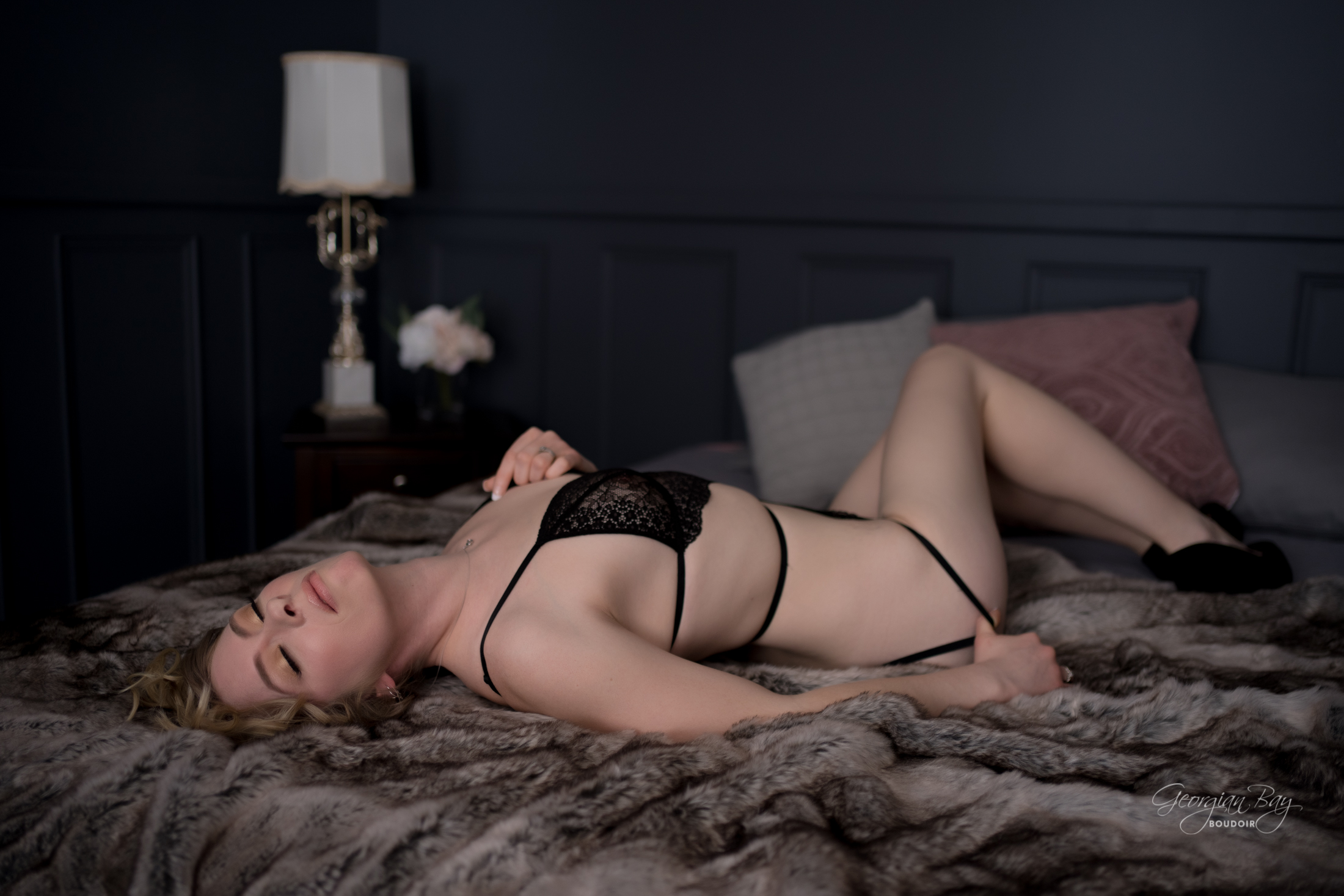 Beautiful blond woman poses in Parry Sound boudoir studio