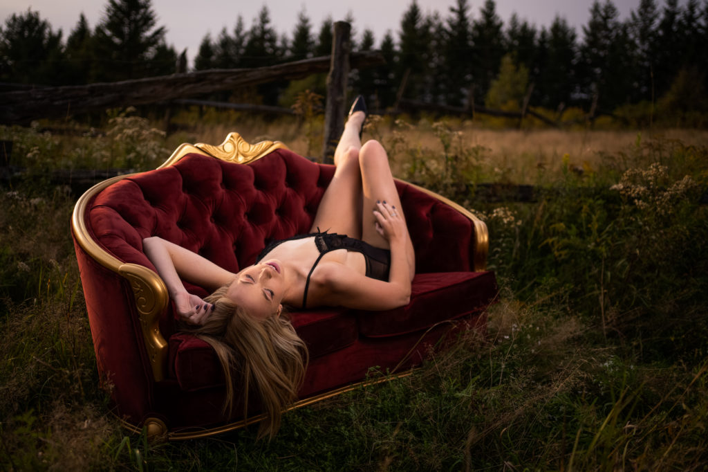 Beatiful outdoor boudoir with woman on couch
