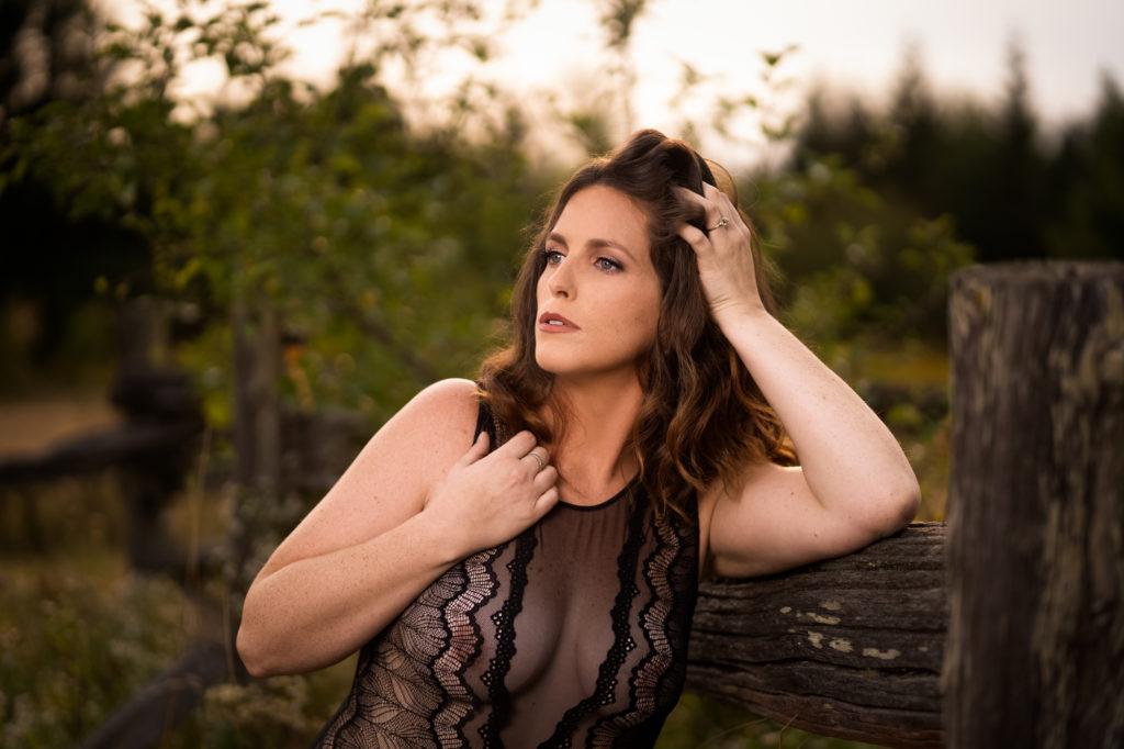 Outdoor boudoir with beautiful woman in black bodysuit